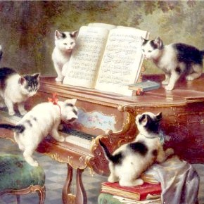 коти за роялем