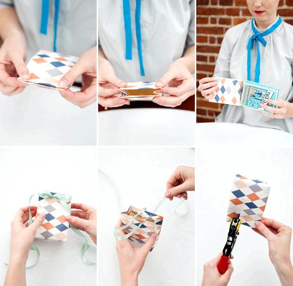 Як зробити оригінальні подарункові пакети своїми руками: Крок 2Дироколом проколюємо обгортковий папір з відкритою боку, і в створені отвори протягуємо стрічки, які будуть