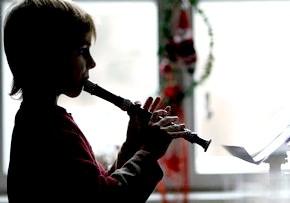 дитина в музичній школі