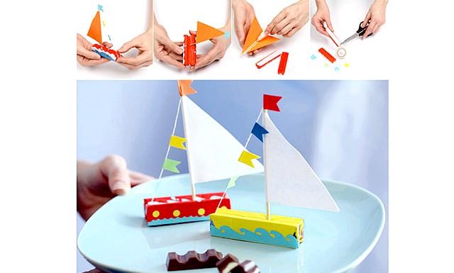 Робимо самі: подарунки до 23 лютого: [u] Потрібні: [/ u] дерев'яні шпажки, кольоровий папір, двосторонній скотч, товсті бавовняні нитки яскравих кольорів, клей ПВА, дві прямокутні шоколадки в обгортці,